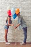 Couples adolescents élégants Photos libres de droits