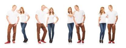 Couples adolescents élégants d'isolement sur le blanc Photographie stock libre de droits