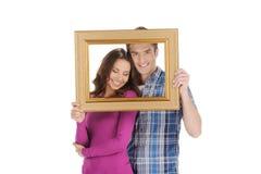 Couples affectueux dans le cadre de tableau. Photographie stock