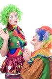 Couples affectueux drôles des clowns Images stock