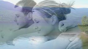 Couples appréciant le massage sur le fond paisible banque de vidéos