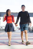 Couples asian younger man and woman hand by hand walking with ha Stock Photography