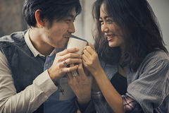 Couples of asian younger man and woman happiness emotion with ho Stock Image