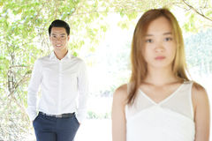 Couples asiatiques dans des relations malheureuses Image stock