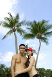 Couples asiatiques de plage Image libre de droits