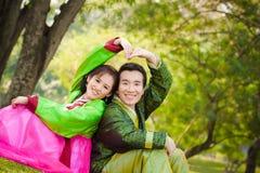 Couples asiatiques heureux Image stock