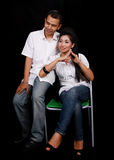 Couples asiatiques sur le noir Images stock