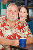Couples attrayants en café Photo libre de droits