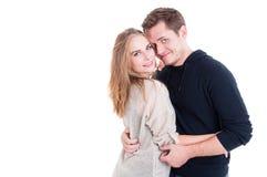 Couples attrayants posant en tant qu'étant heureux et joyeux Photographie stock