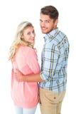 Couples attrayants tournant et souriant à l'appareil-photo Photographie stock