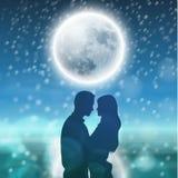 Couples au-dessus de fond avec la lune et les flocons de neige Photographie stock