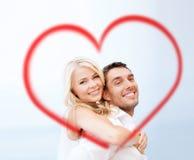 Couples ayant l'amusement sur la plage Image stock