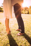 Couples bare feet standing on grass Stock Photo