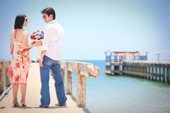 Couples on beach pier Royalty Free Stock Photos