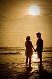 Couples at Beach sunset Stock Photography