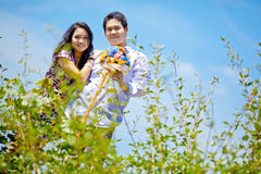 Couples with beautiful meadows Stock Photography