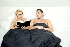 Couples bed story Royalty Free Stock Photos