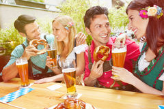 Couples in beer garden in summer Stock Image