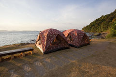 Couples of camping tent in font of sea beach with morning light Stock Photo