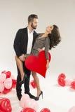 Couples caucasiens de sourire de jeunes Photographie stock libre de droits