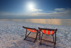 Couples chairs beach at sea side Stock Photos