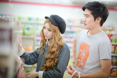 The Couples are choosing to shop in the supermarkets . Royalty Free Stock Photo