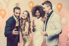Couples in a club celebrating new years eve dancing into midnight royalty free stock photo