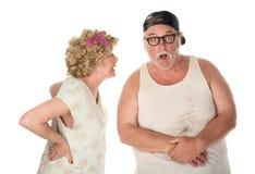 Couples combattant ou partageant le secret choquant Image libre de droits