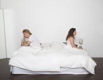 Couples contrariés Photo stock