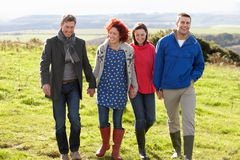 Couples on country walk Stock Images