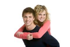 Couples d'adolescent attrayants, conduite de ferroutage Image stock