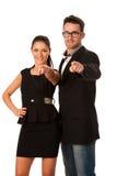 Couples d'affaires encourageant à agir et succès par le pointage avec Photo libre de droits