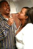 Couples d'Afro-américain sous le parapluie Photographie stock