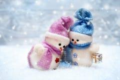 Couples d'amour de bonhommes de neige Photographie stock