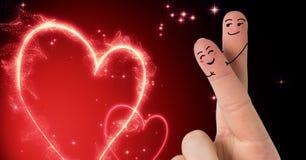 Couples d'amour des doigts de Valentine et coeurs lumineux Photographie stock