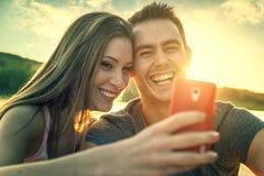 Couples d'amour souriant, selfie en gros plan de photo Image stock