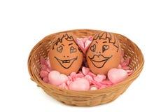 Couples d'oeufs d'arts et de visage Photos stock
