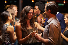 Couples Dancing And Drinking At Evening Party Royalty Free Stock Images