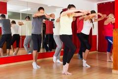 Couples dancing modern style dance. Active smiling couples dancing modern style dance in class stock photos