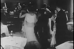 Couples dancing in night club while band plays, 1930s stock video footage