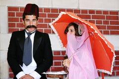 Couples dans des costumes de tabouret Photo libre de droits