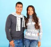 Couples dans des pulls Photographie stock