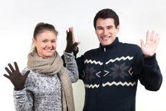Couples dans des vêtements d'hiver Photos libres de droits