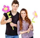 Couples dans l'amour avec la fleur Photographie stock libre de droits