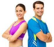 Couples dans l'usage de sports se tenant de nouveau au dos Photographie stock