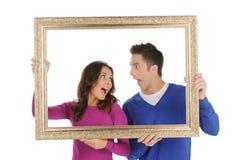 Couples dans le cadre. Photo stock