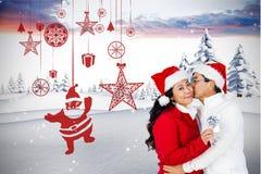 Couples dans le chapeau de Santa embrassant sur le fond digitalement produit Photo stock