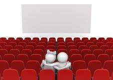 Couples dans le cinéma Photo stock