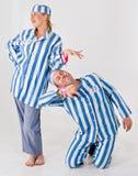 Couples dans le costume de prisonnier Images stock