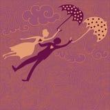 Couples dans le vol d'amour avec des parapluies Photographie stock libre de droits